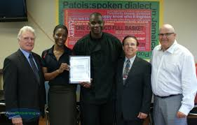 Patois Restaurant excepting an Award with Councilmen